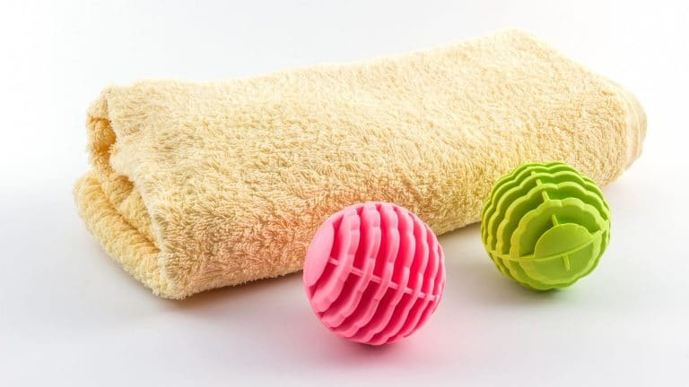 Can you safely put tennis balls in the washing machine